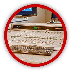 Console board with audio sliders in red circle