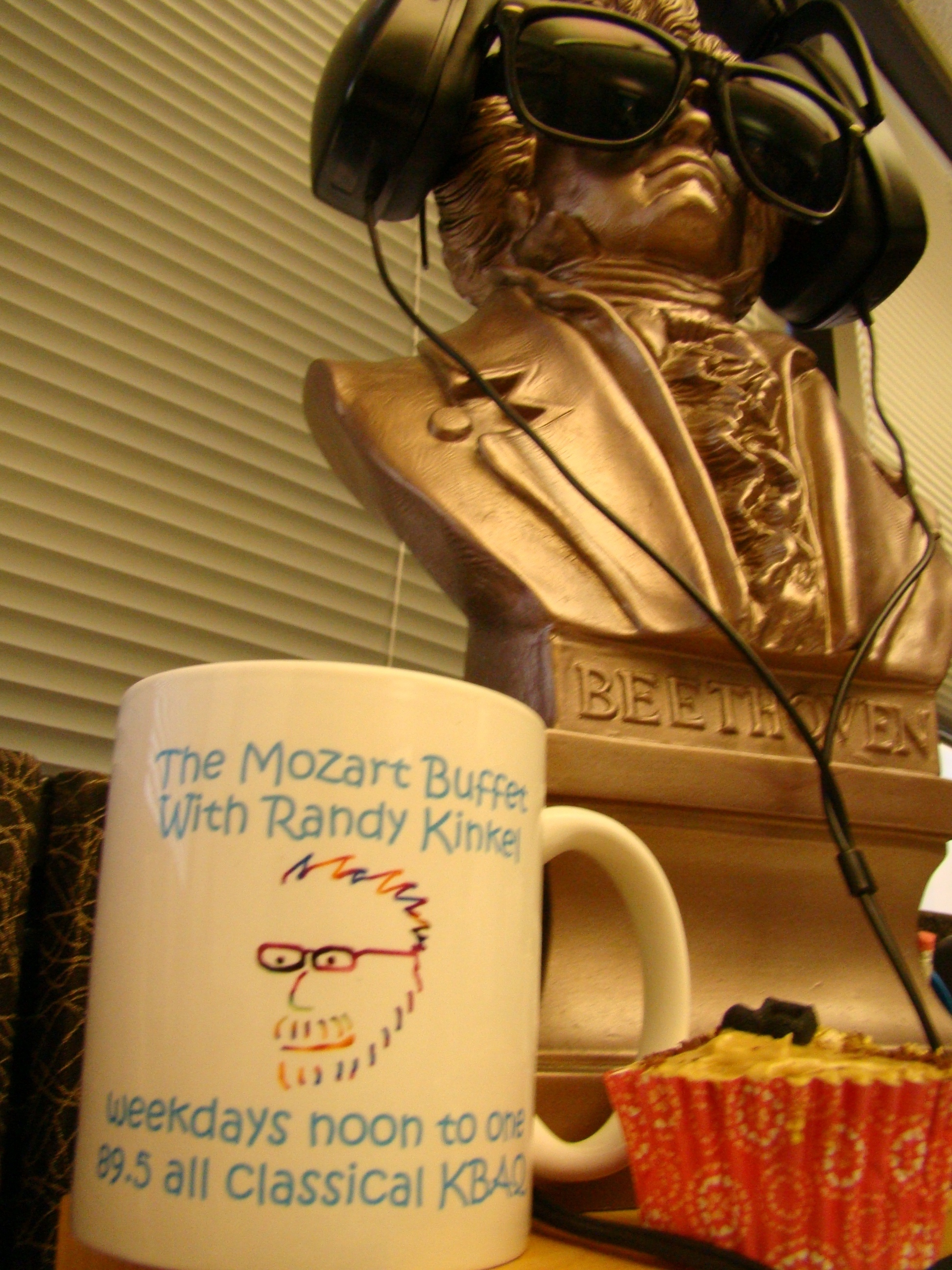 Randy Kinkel offers the Mozart Buffet Mug as a Birthday prize on the Mozart Buffet, Noon to One!